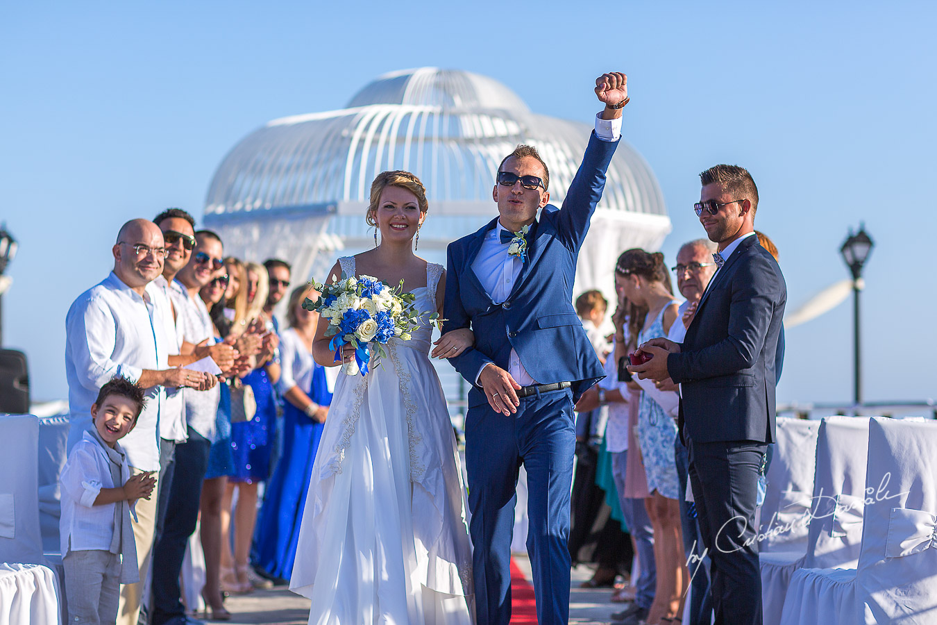 Just seconds after the ceremony, the groom is showing his enthusiasm at Elias Beach Hotel in Limassol