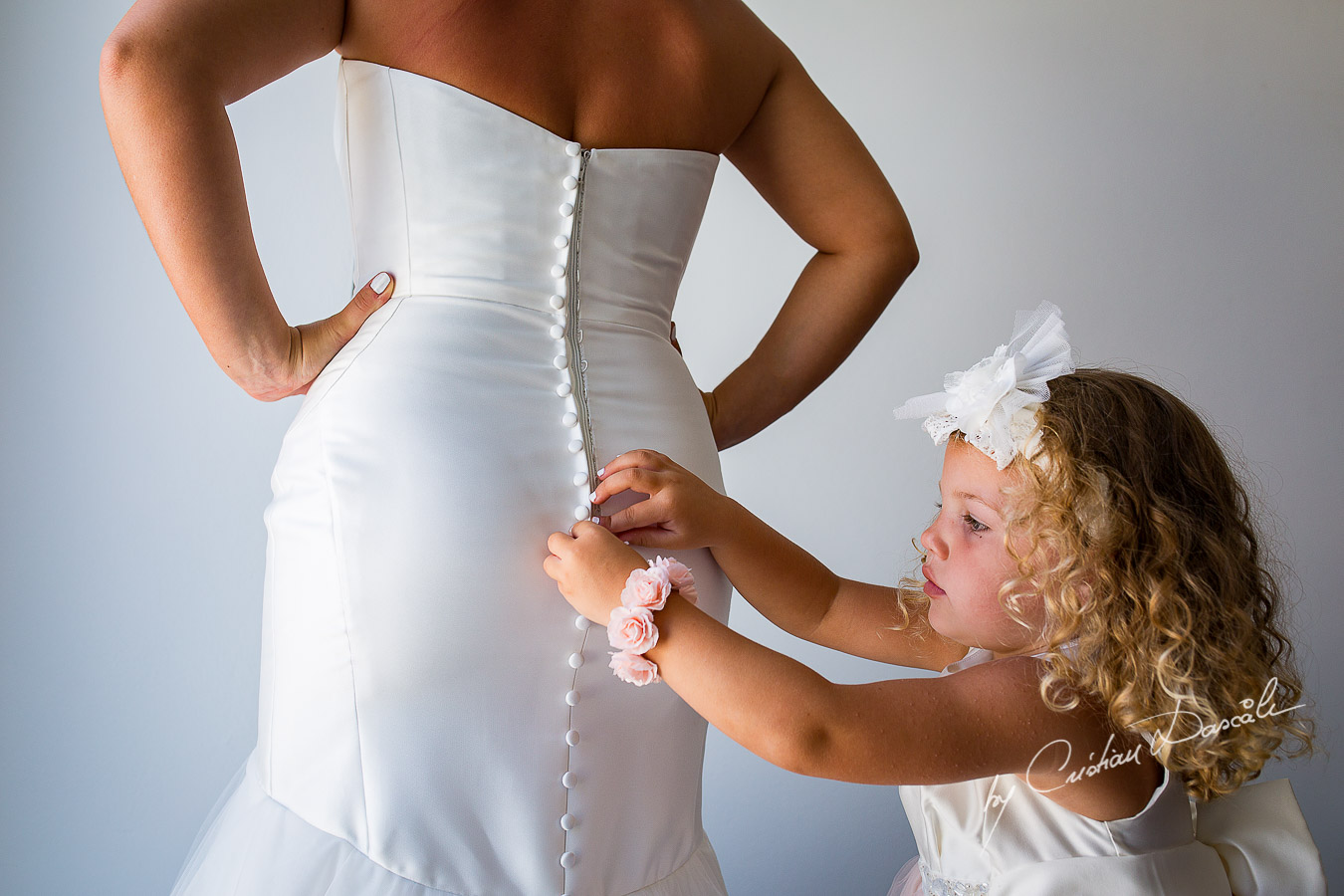 Little Eva helping her mother to tie up the wedding dress.