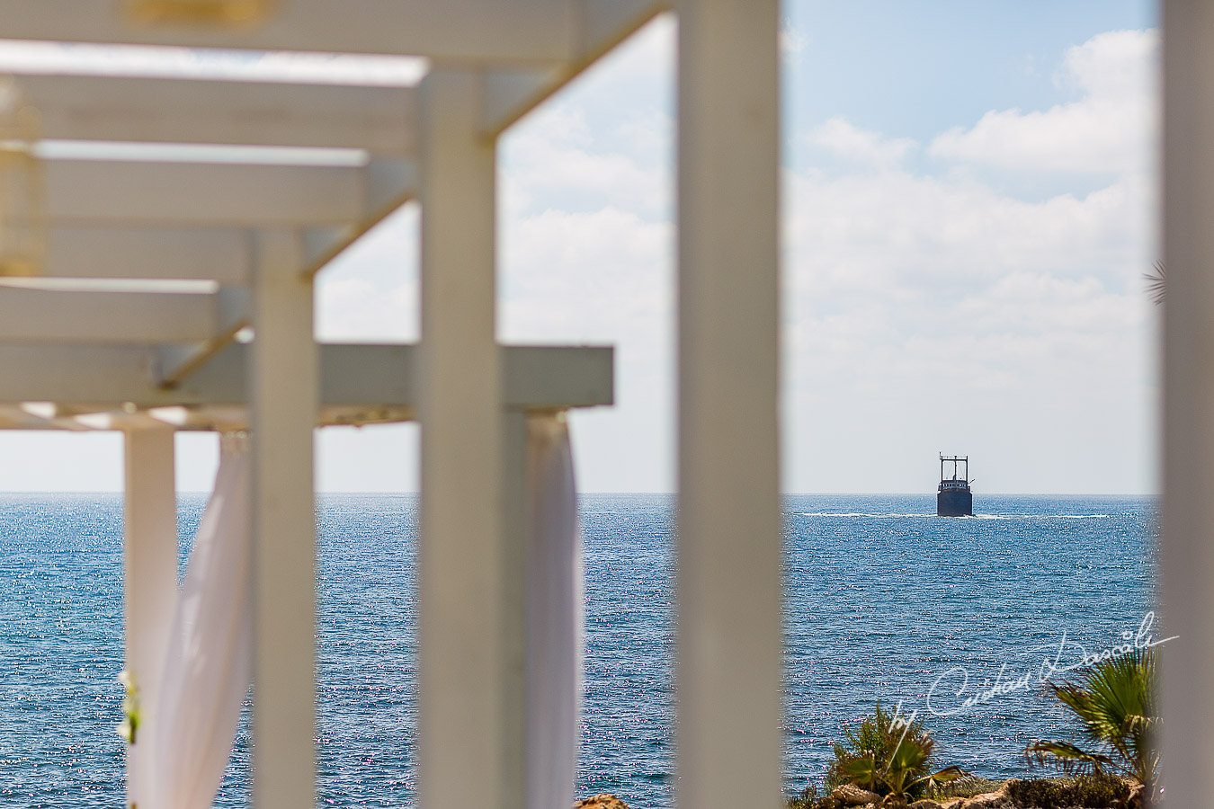 Ship wreck off coast of Paphos seen from wedding ceremony at King Evelton Beach and Resort.
