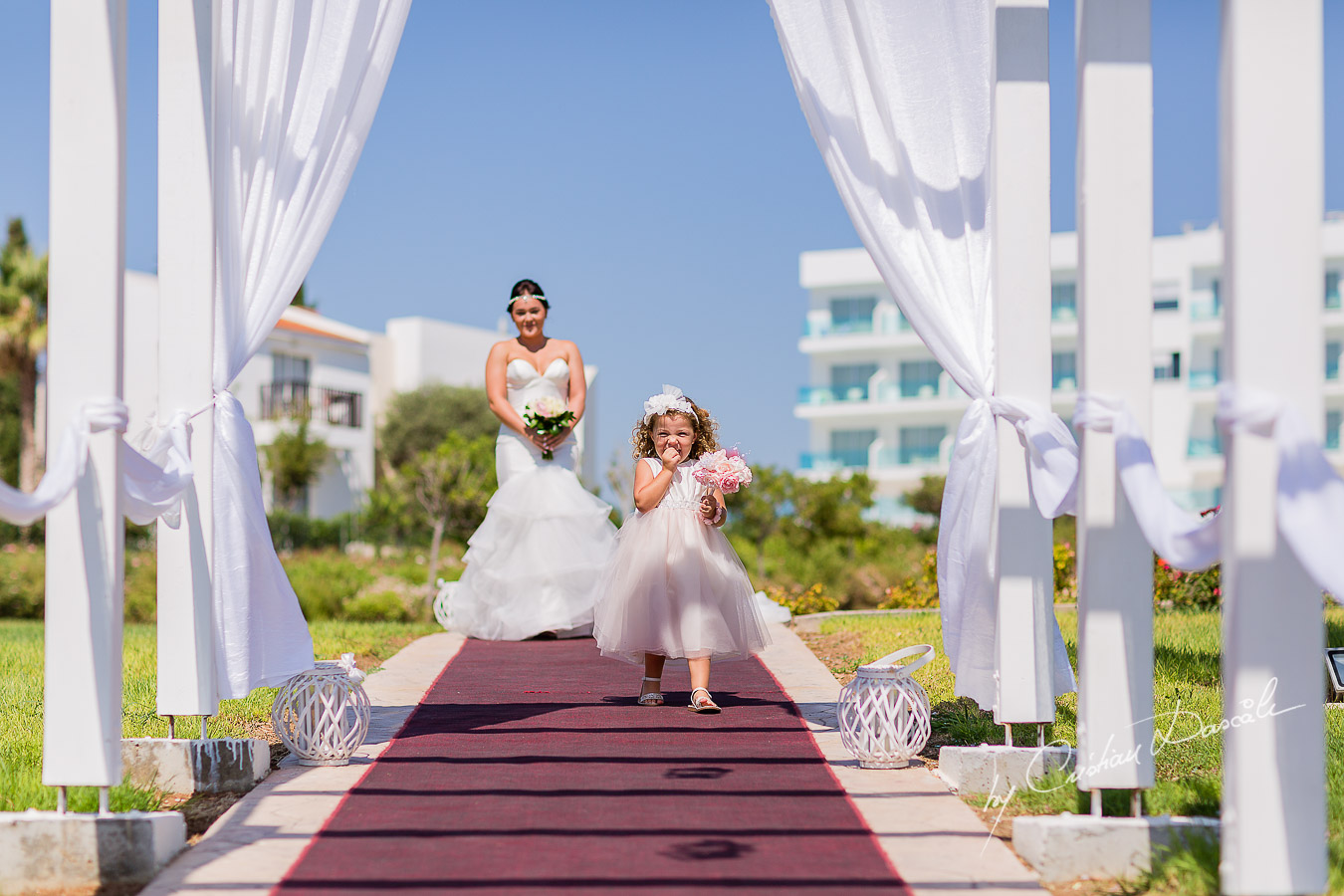 Eva, the flower girl and Amy, the bride, arriving at the wedding ceremony at King Elvelton Hotel and Resort in Paphos, Cyprus.