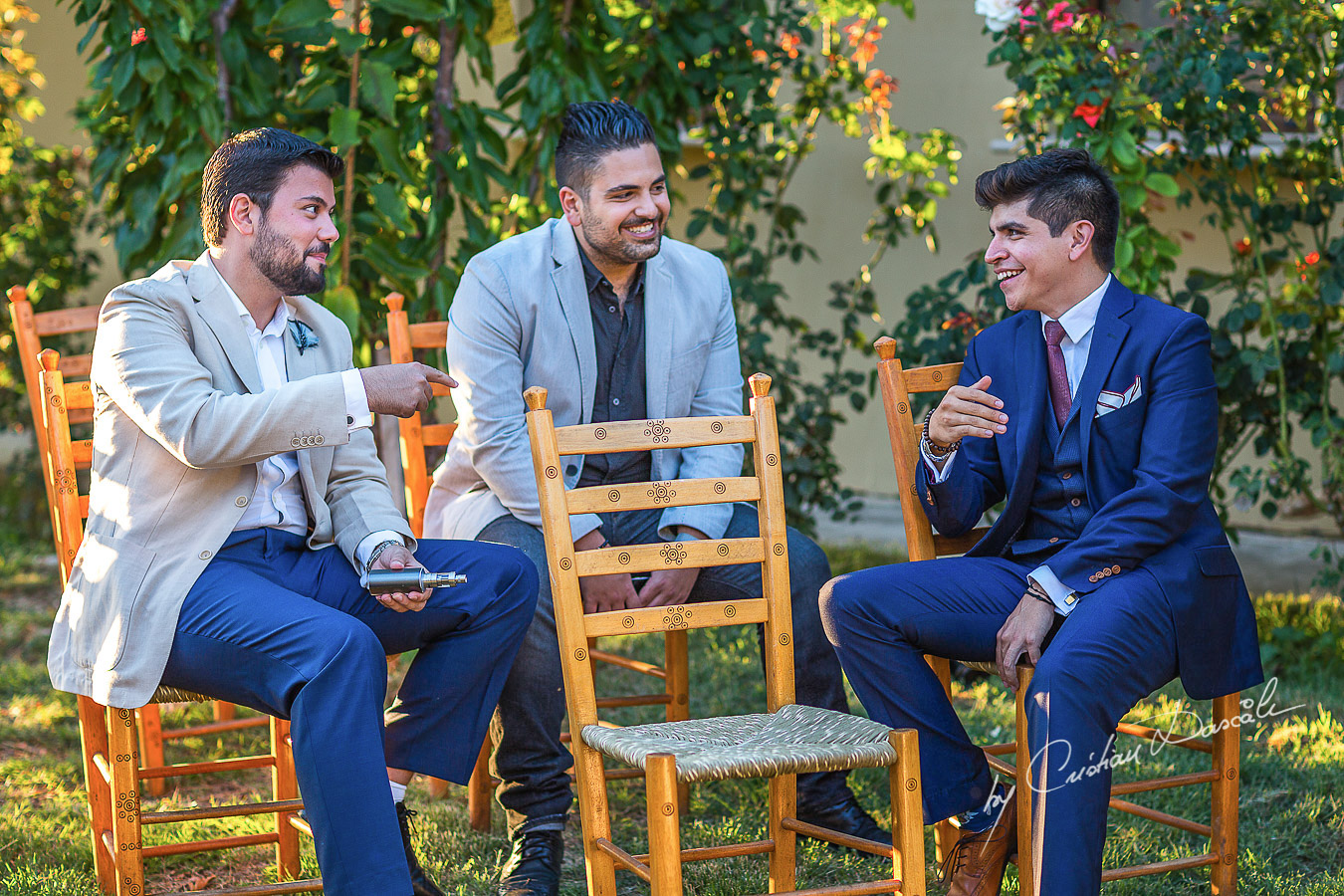 Guests laughing with the groom at a beautiful bohemian wedding in Trimiklini.