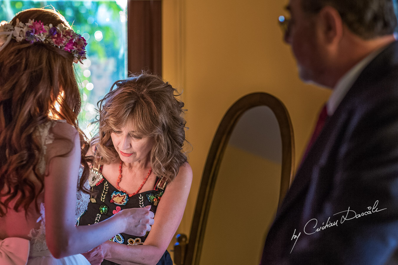 The mother of the bride takes care of the final preparations for the bride before her bohemian wedding at Villa in Trimiklini.