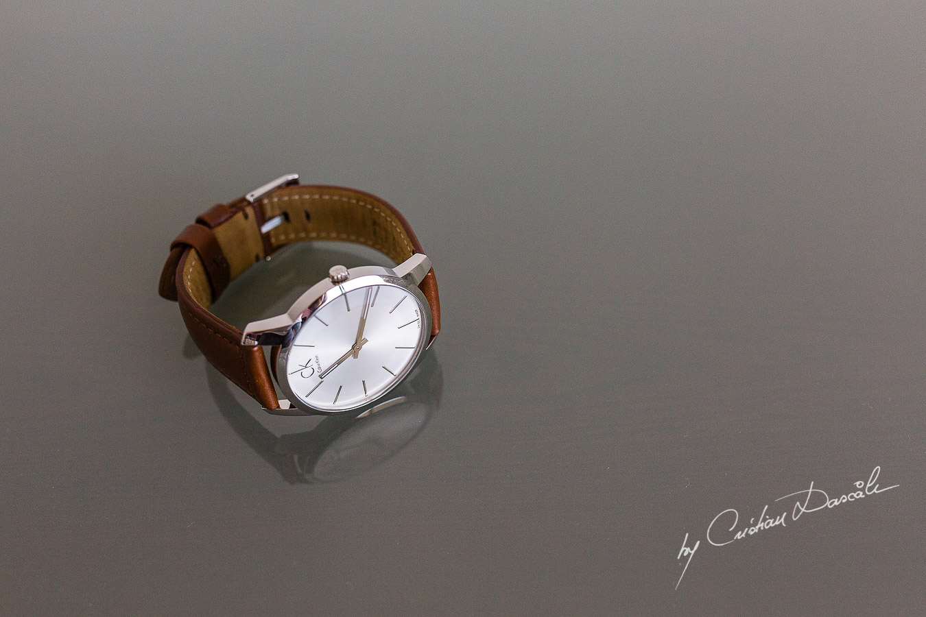 Groom's watch captured at an elegant and romantic wedding at Elias Beach Hotel by Cristian Dascalu.