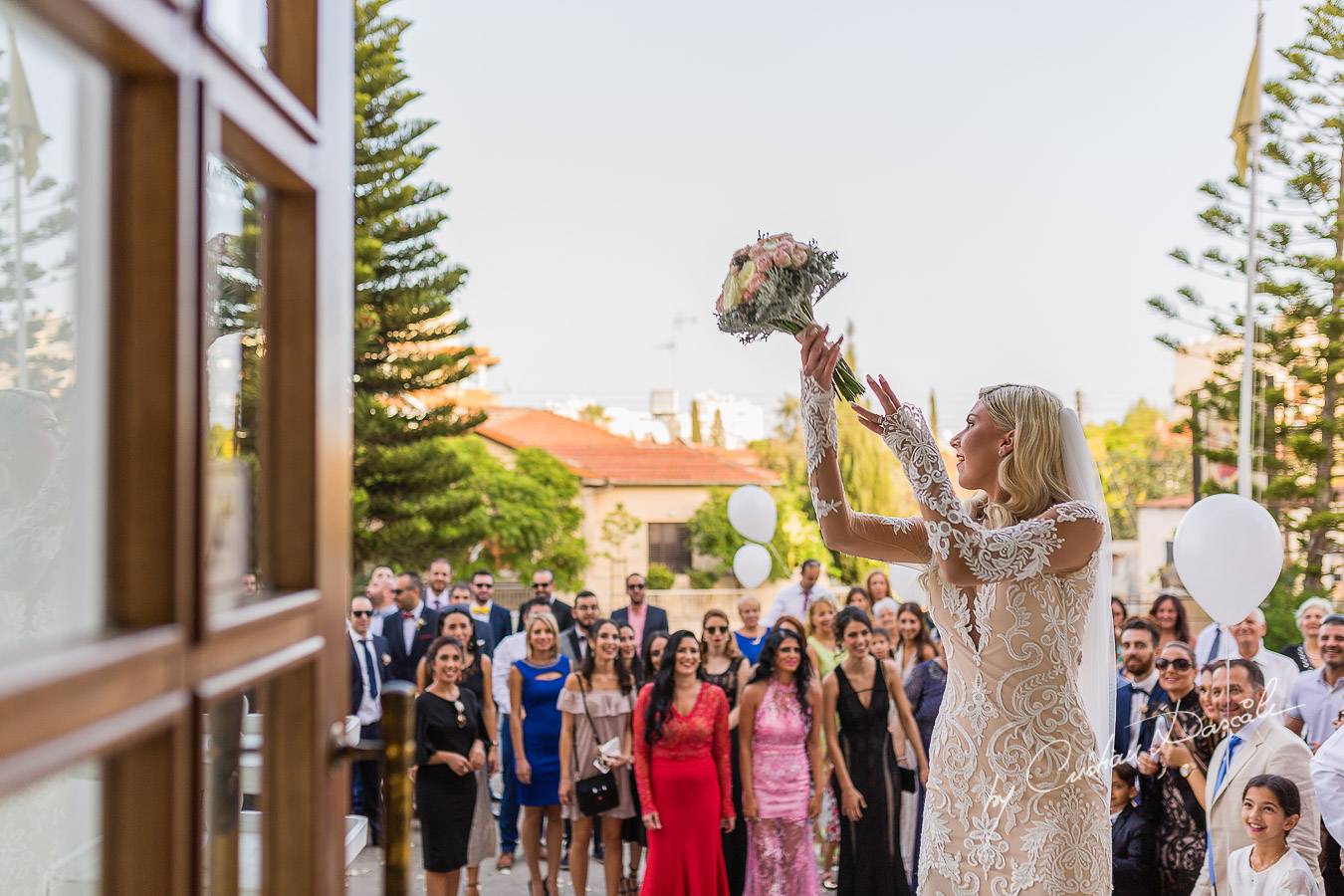 Immediate moments after the church ceremony captured at an elegant and romantic wedding at Elias Beach Hotel by Cristian Dascalu.