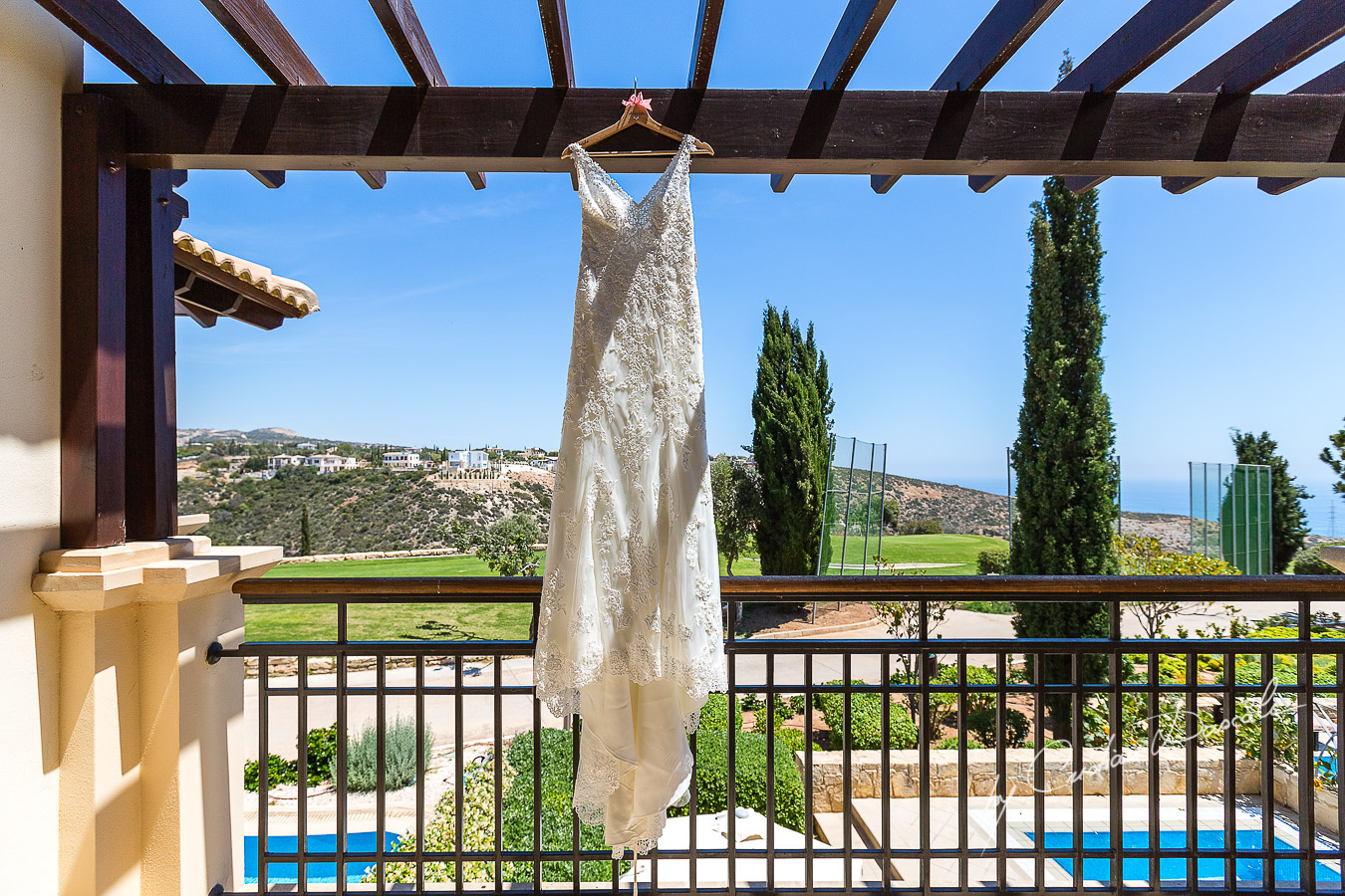 Bride's details at Aphrodite Hills Resort captured during a wedding by Cristian Dascalu.