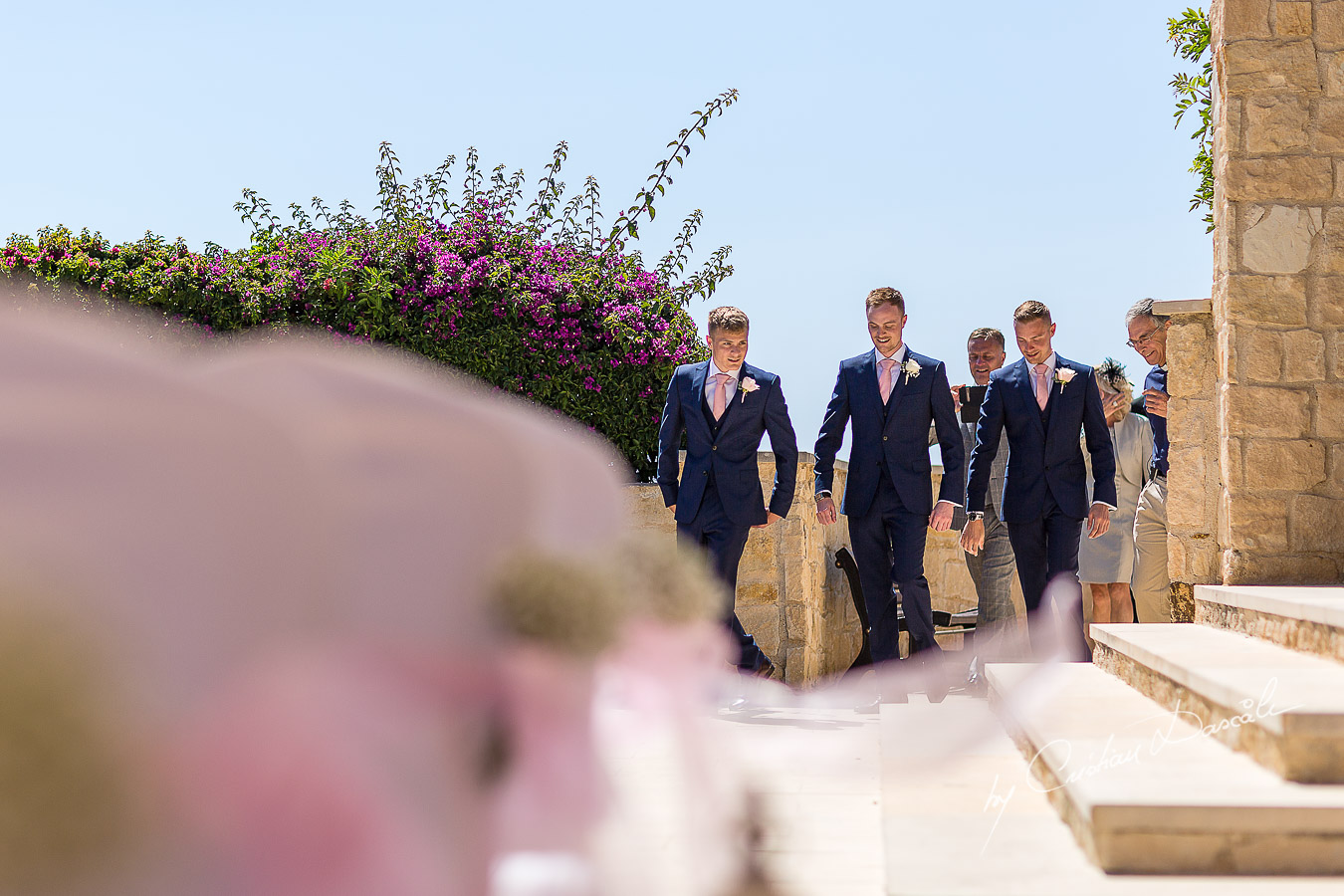The moment when the groom arrives at the wedding ceremony captured at Aphrodite Hills Resort in Cyprus by photographer Cristian Dascalu.