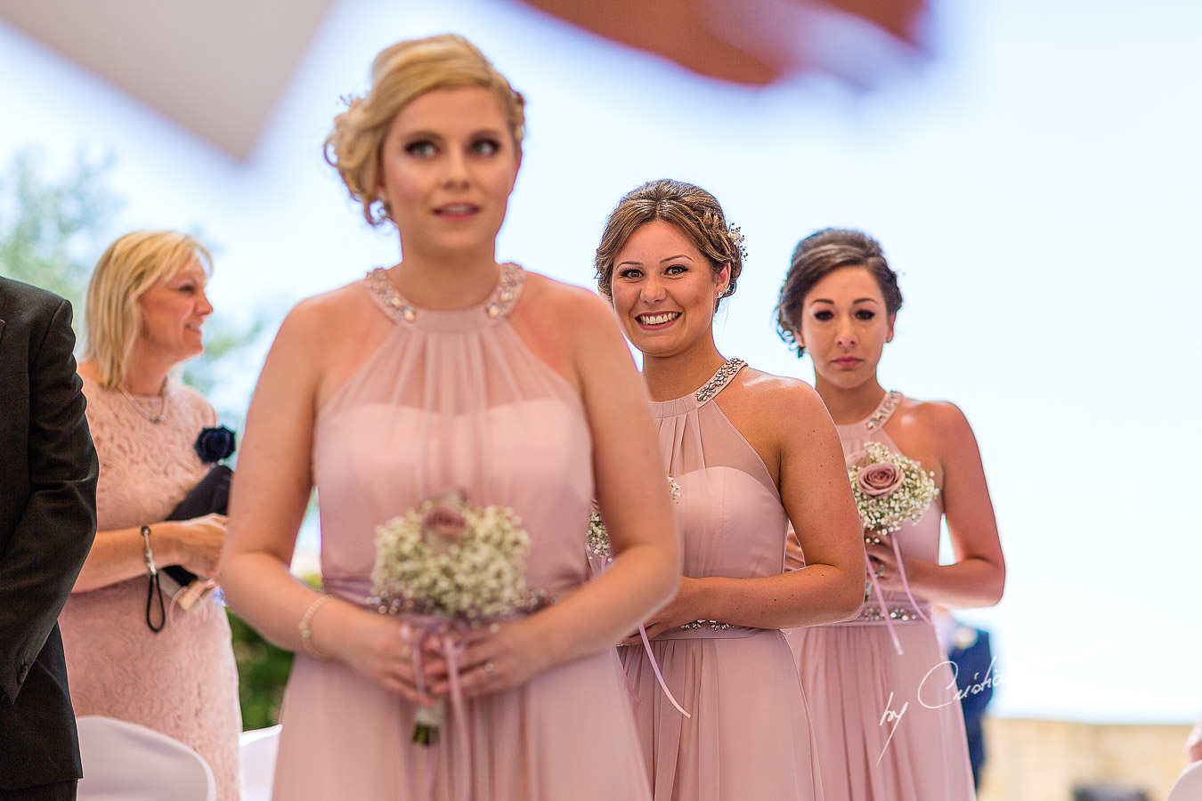 The moment when the bridesmaids arrive at the wedding ceremony at Aphrodite Hills Resort in Cyprus, captured by photographer Cristian Dascalu.
