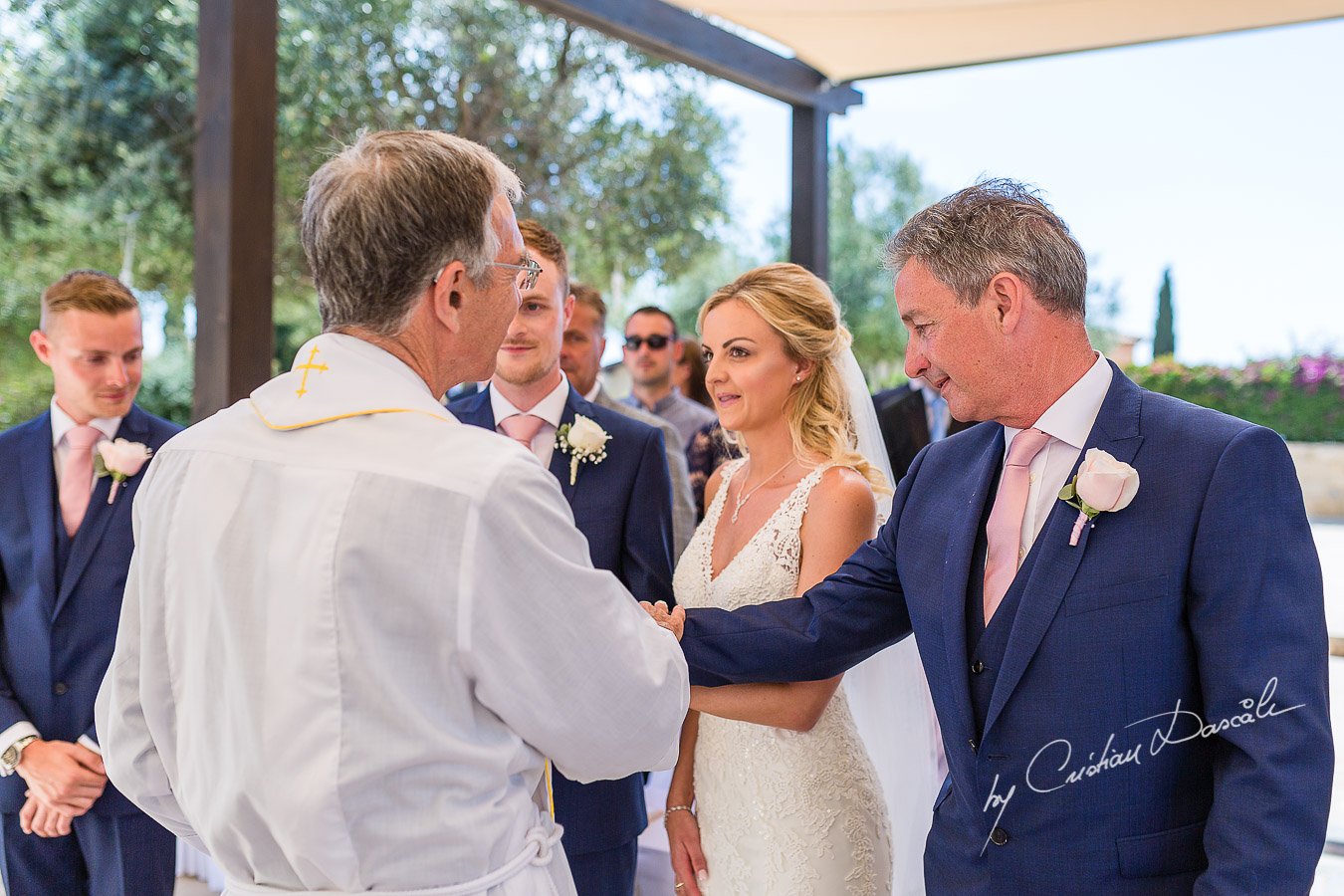The father of the bride's reaction when the bride arrives at the wedding ceremony at Aphrodite Hills Resort in Cyprus, captured by photographer Cristian Dascalu.