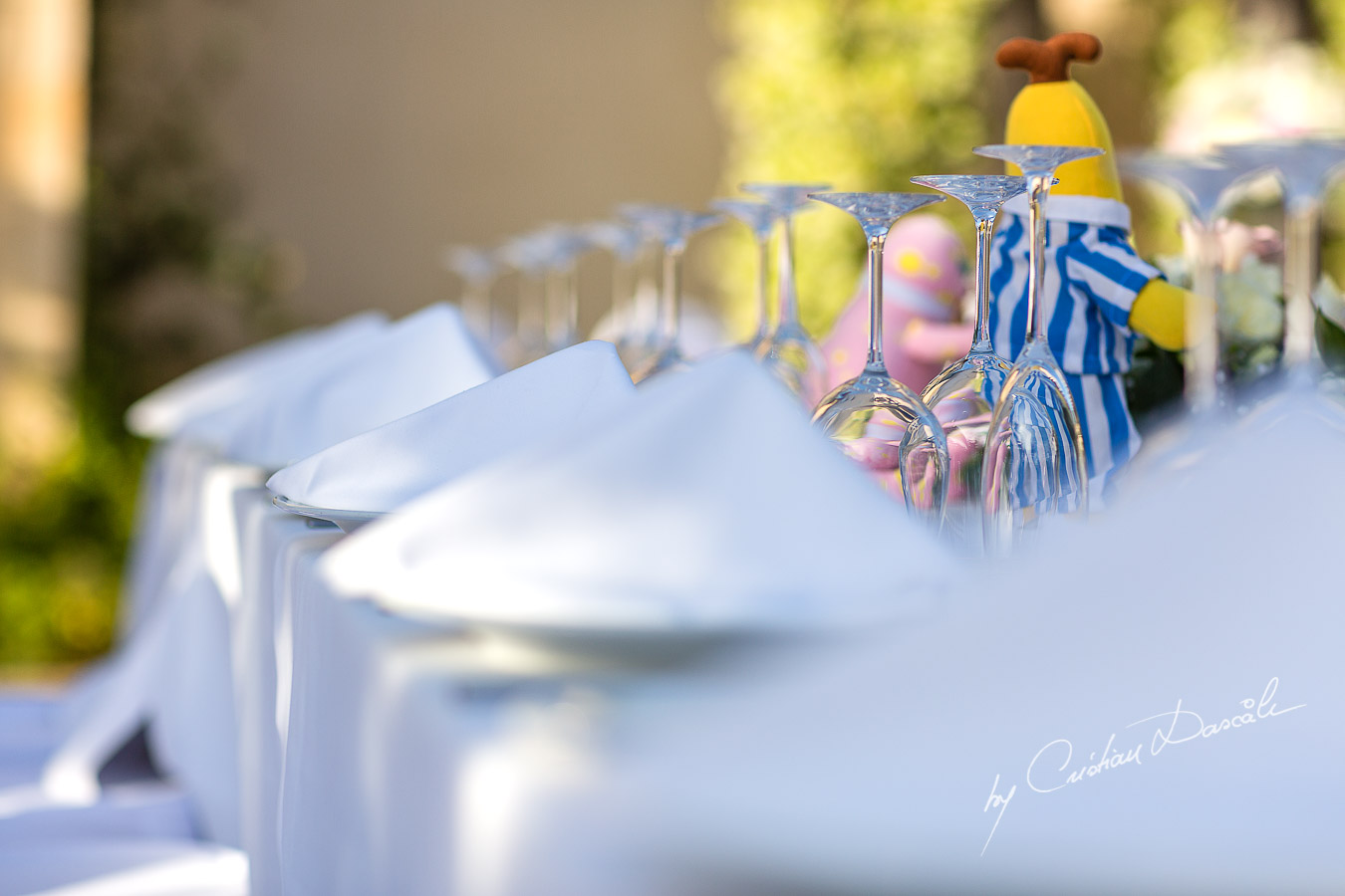 Beautiful wedding table decorations captured by Cristian Dascalu at a wedding at The Aphrodite Hills Resort in Paphos, Cyprus.