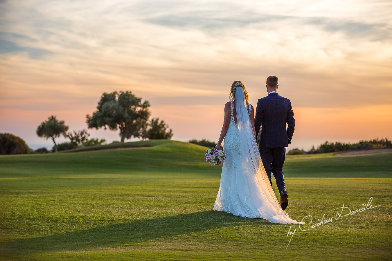 Sunset photoshoot moments captured by Cristian Dascalu at a wedding at The Aphrodite Hills Resort in Paphos, Cyprus.