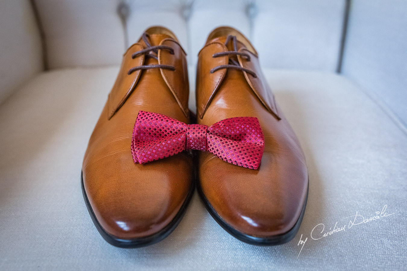 Groom's shoes and bow-tie photographed at a wedding in Nicosia by Cyprus Wedding Photographer Cristian Dascalu
