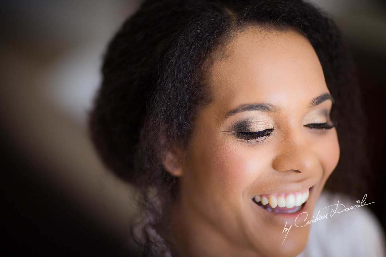 Beautiful smile of the bride Joanna captured at her wedding at Minthis Hills in Cyprus, by Cristian Dascalu.