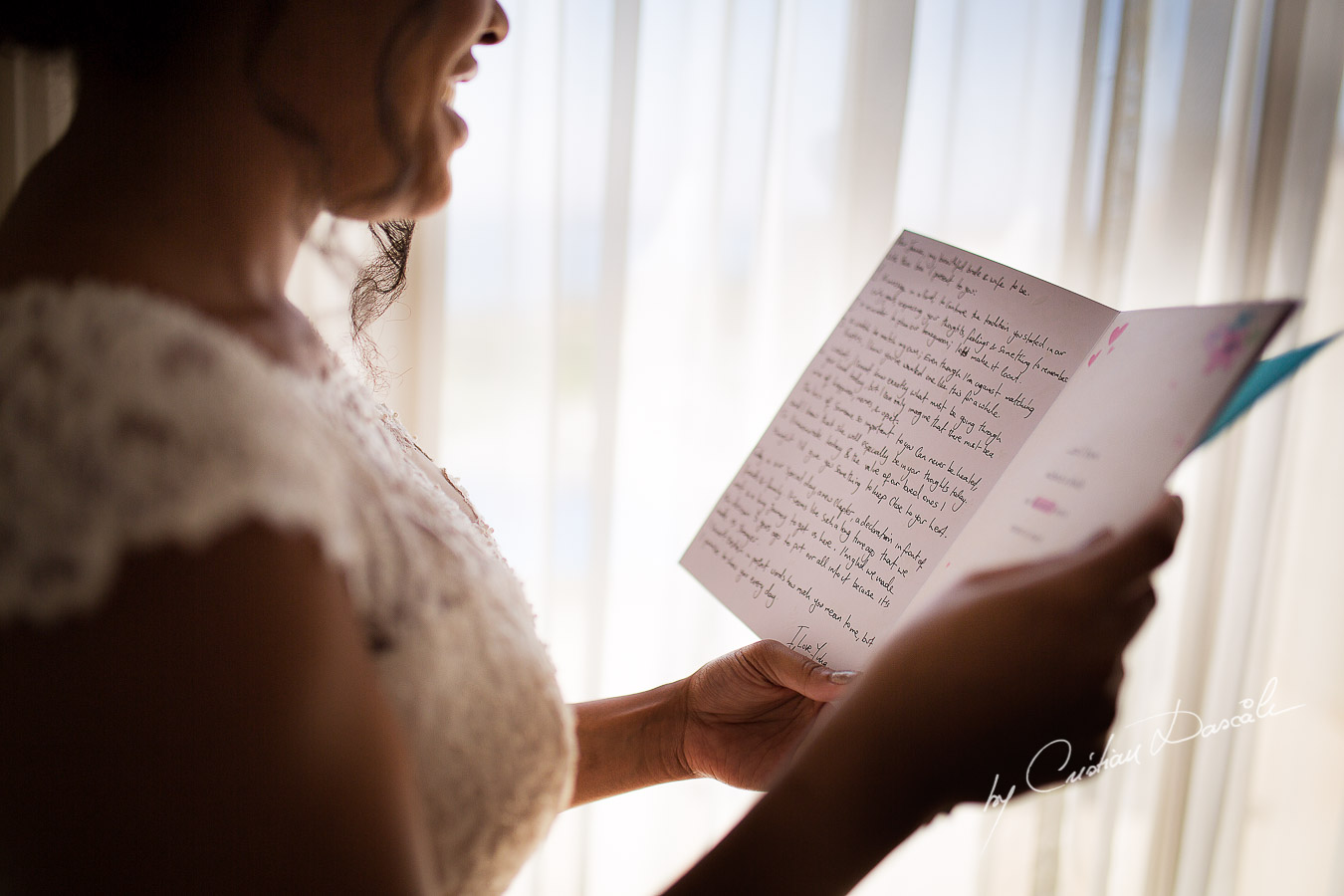 Genuine moments when the bride is reading her letter from the groom captured at a wedding at Minthis Hills in Cyprus, by Cristian Dascalu.