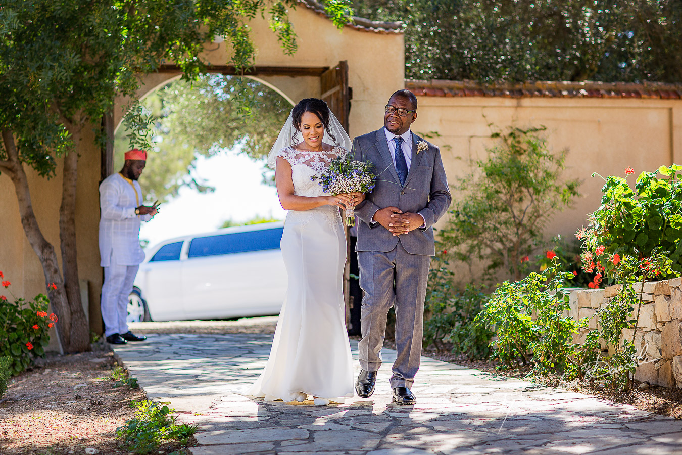 Emotional moment with the bride and her father captured at a wedding at Minthis Hills in Cyprus, by Cristian Dascalu.