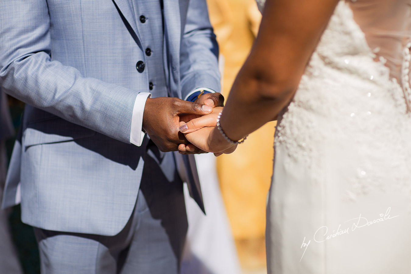 Moments and the bride and the groom are holding hands captured at a wedding at Minthis Hills in Cyprus, by Cristian Dascalu.