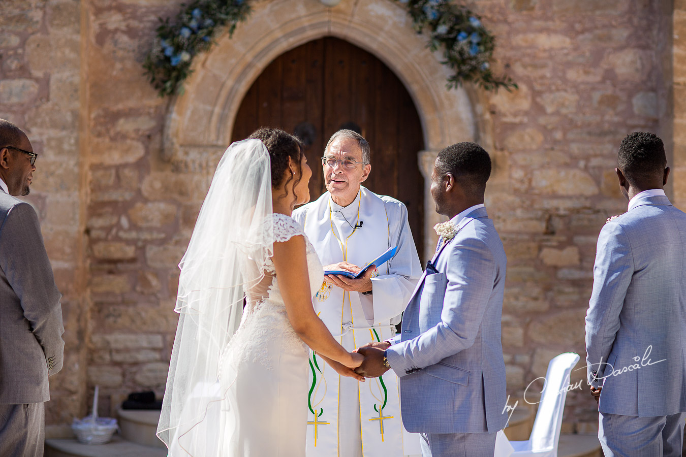 Beautiful ceremony moments captured at a wedding at Minthis Hills in Cyprus, by Cristian Dascalu.