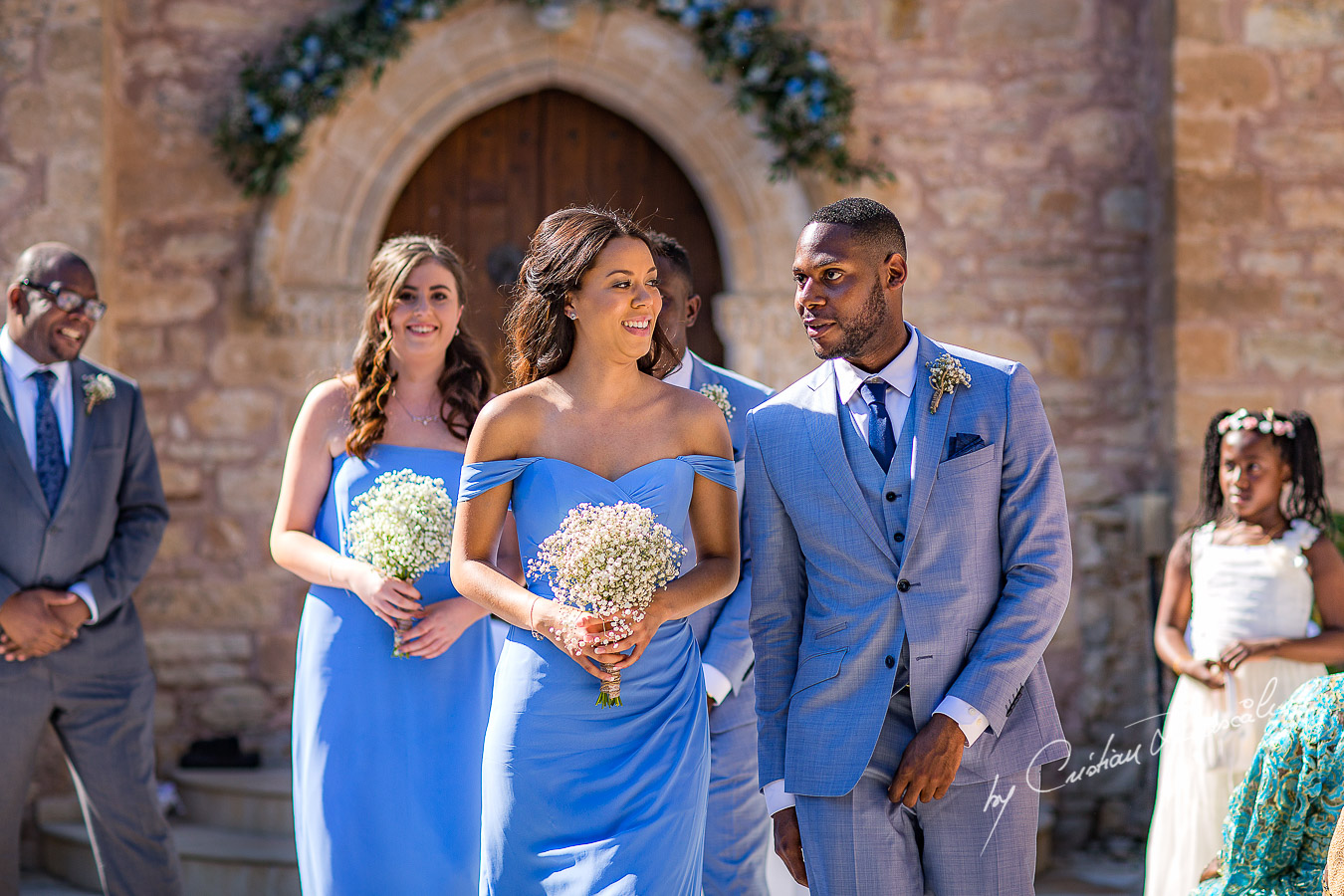 Bridesmaids and Groomsmen follow the bride and groom, moments captured at a wedding at Minthis Hills in Cyprus, by Cristian Dascalu.