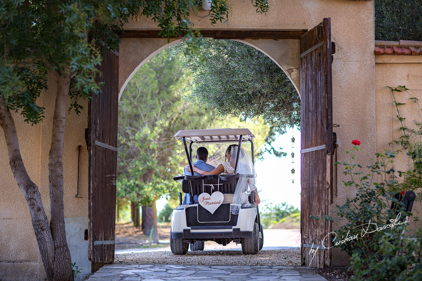 Bride and groom getting away in the bridal bug, moments captured at a wedding at Minthis Hills in Cyprus, by Cristian Dascalu.