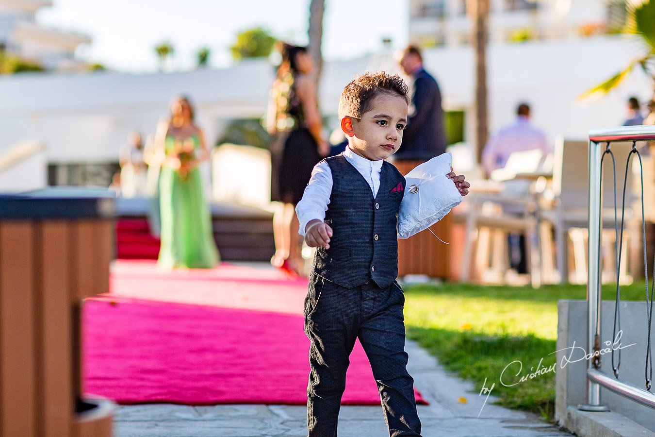 Paige boy photographed during the ceremony, as part of an Exclusive Wedding photography at Grand Resort Limassol, captured by Cyprus Wedding Photographer Cristian Dascalu.