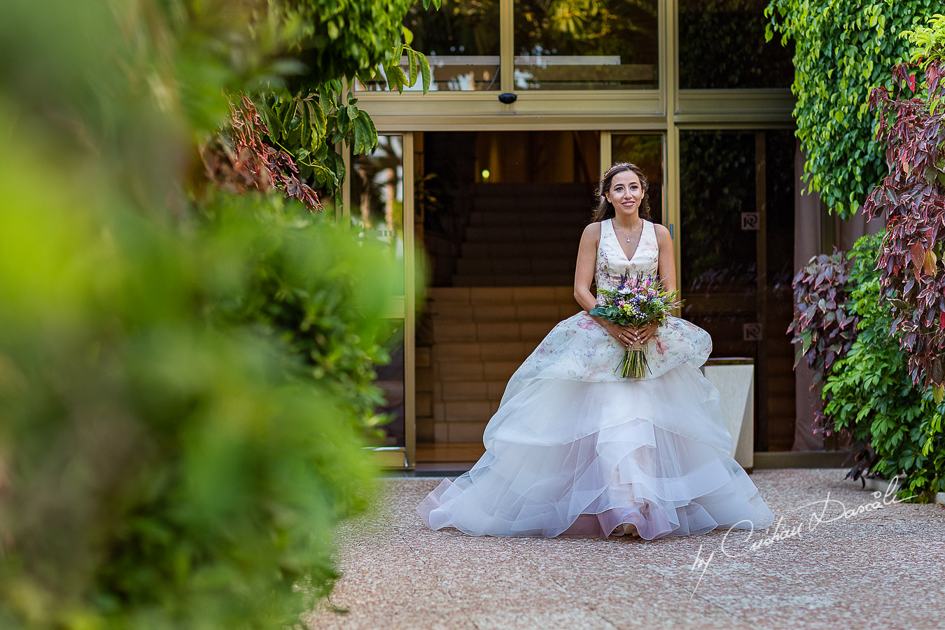 The bride coming down the isle photographed during the ceremony, as part of an Exclusive Wedding photography at Grand Resort Limassol, captured by Cyprus Wedding Photographer Cristian Dascalu.