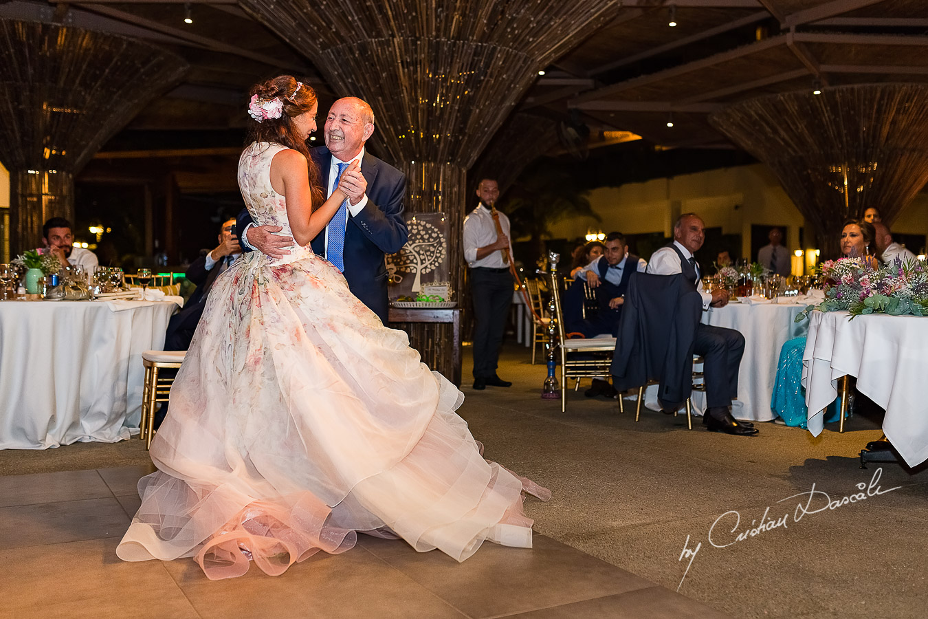 Bride dancing with her father, an emotional moment photographed as part of an Exclusive Wedding photography at Grand Resort Limassol, captured by Cyprus Wedding Photographer Cristian Dascalu.