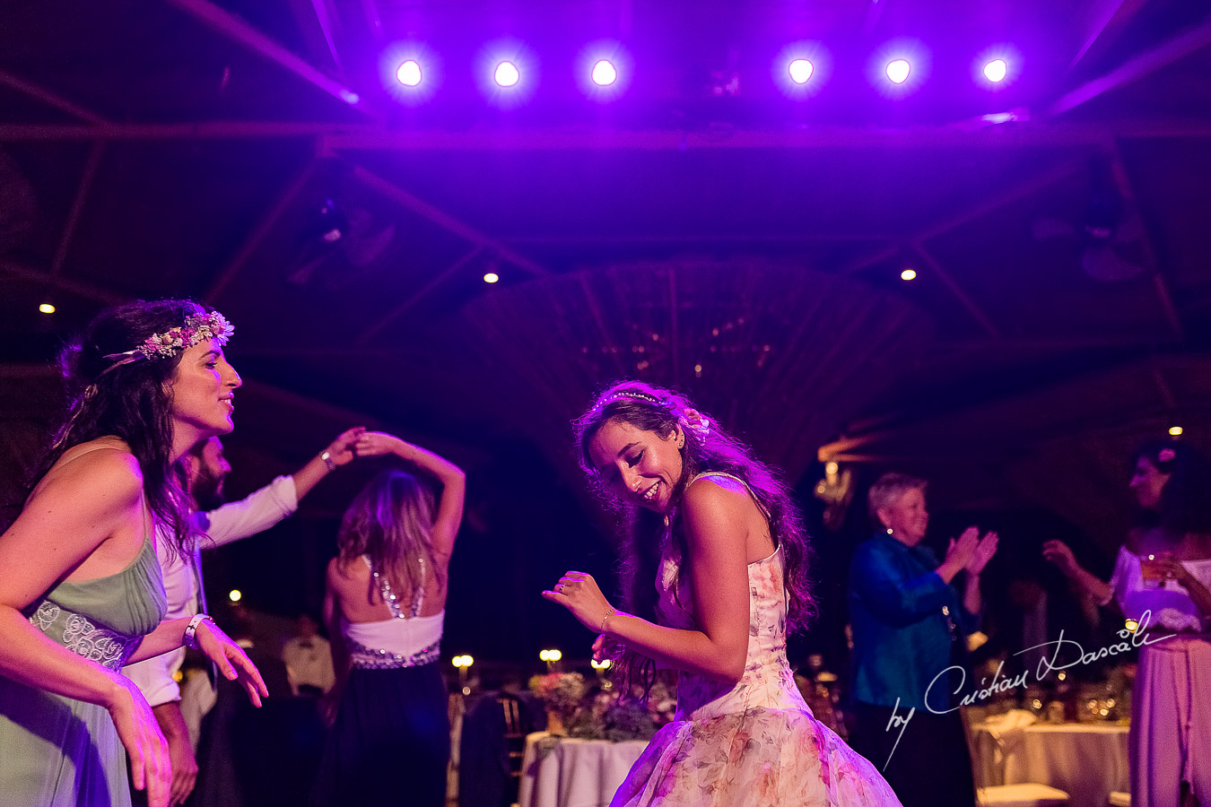 Bride dancing at her wedding, a unique moment photographed as part of an Exclusive Wedding photography at Grand Resort Limassol, captured by Cyprus Wedding Photographer Cristian Dascalu.