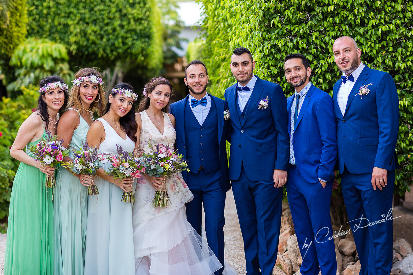 Portrait with the bride and groom and their bridesmaids and groomsmen photographed as part of an Exclusive Wedding photography at Grand Resort Limassol, captured by Cyprus Wedding Photographer Cristian Dascalu.