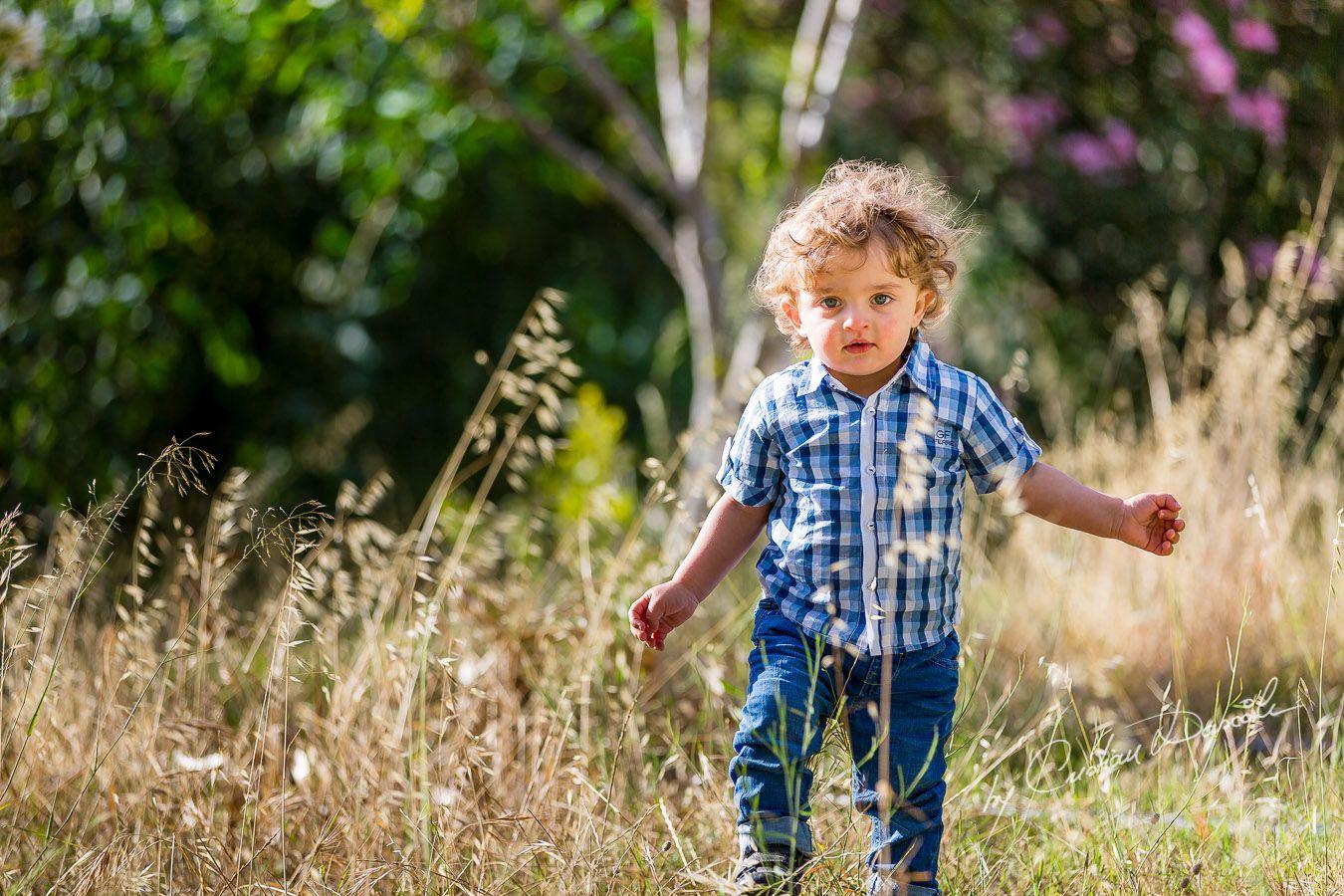 Harry playing on the grass near Curium Beach, Cyprus. Photographer: Cristian Dascalu