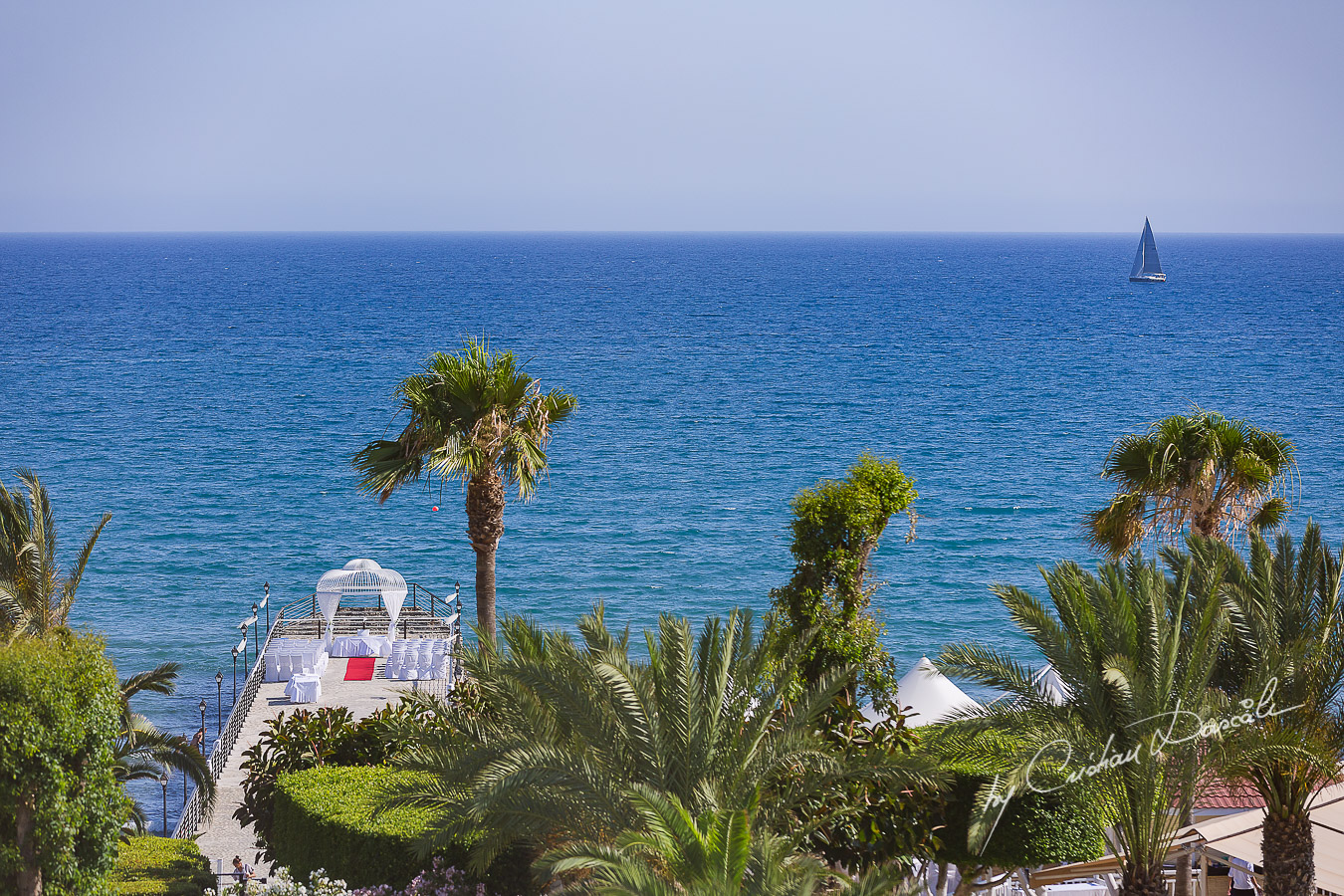 View over the wedding pier at Elias Beach Hotel in Limassol, photographed from the bride's room