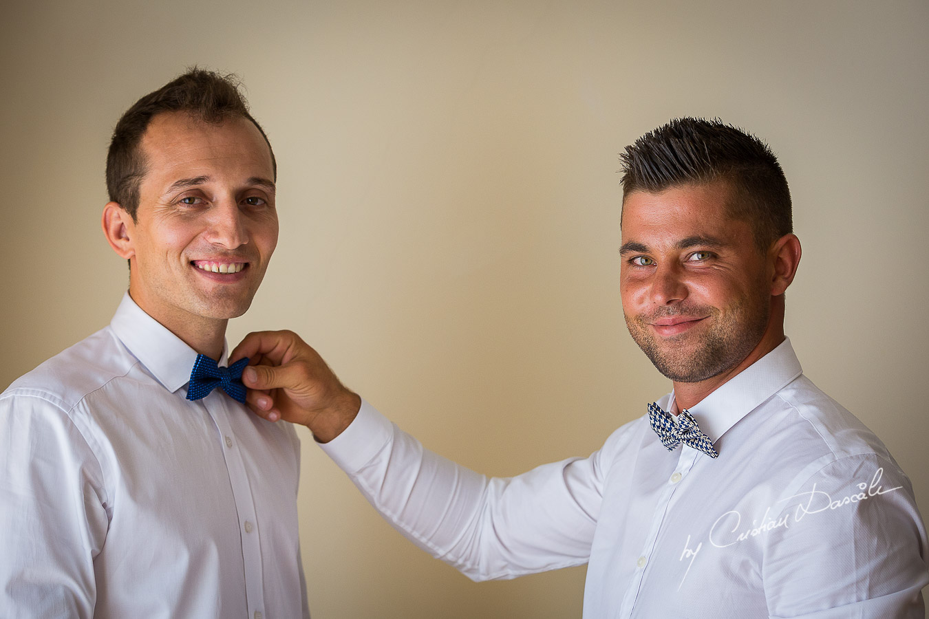 Groom and best man getting ready at Elias Beach Hotel in Limassol