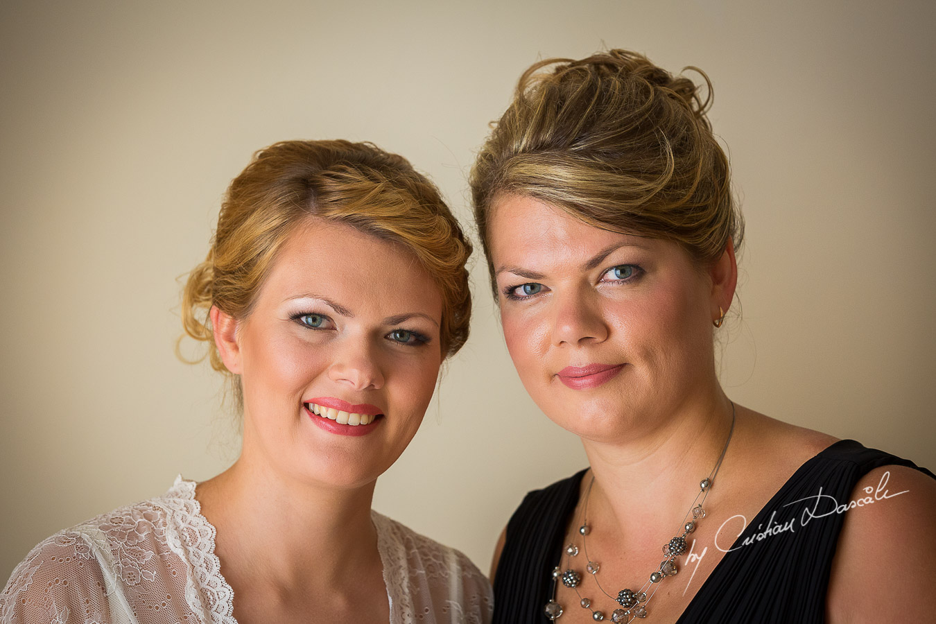Bride Daria and her sister photographed few moments before the wedding at Elias Beach Hotel in Limassol