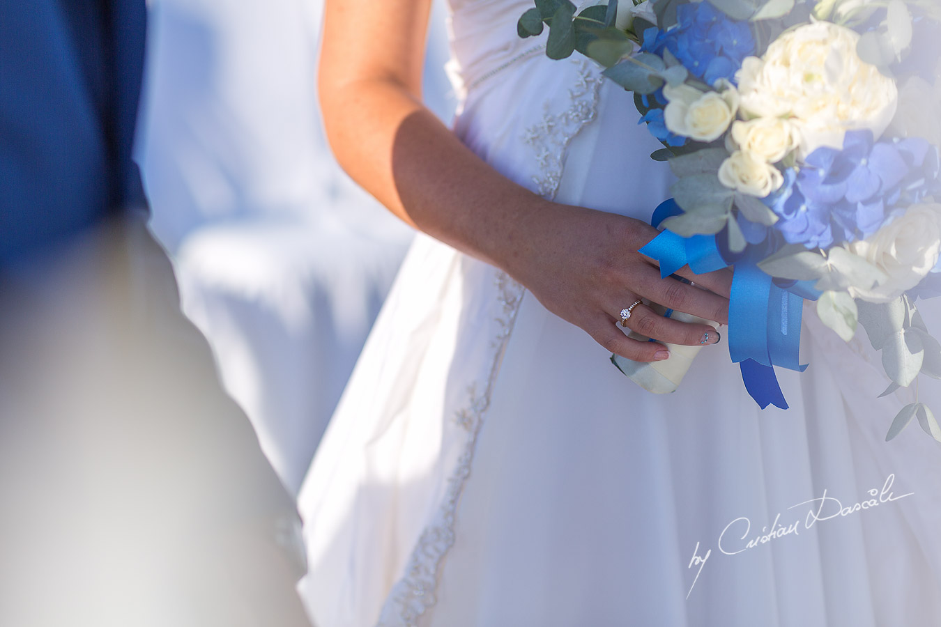 Engagement ring photographed during wedding ceremony at Elias Beach Hotel in Limassol