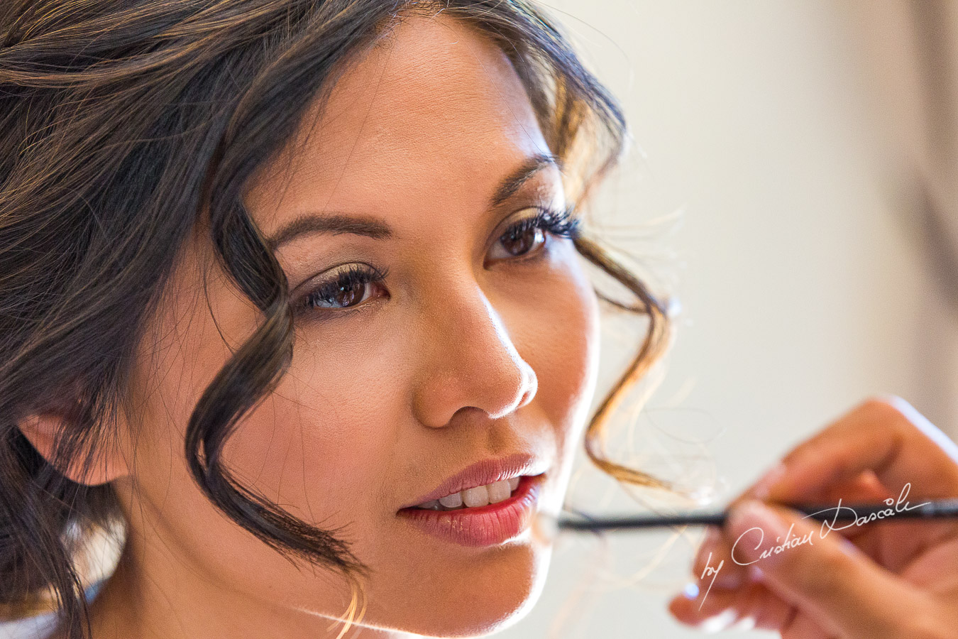 The beautiful bride Marian while make up captured at her wedding in Ayia Napa, Cyprus by Cristian Dascalu.
