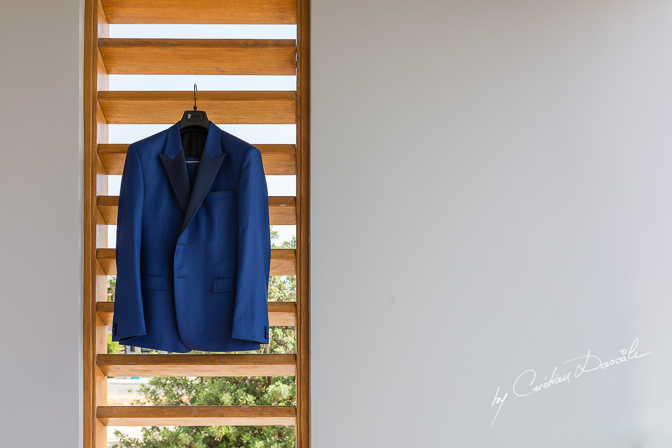 Groom's suit captured at an elegant and romantic wedding at Elias Beach Hotel by Cristian Dascalu.