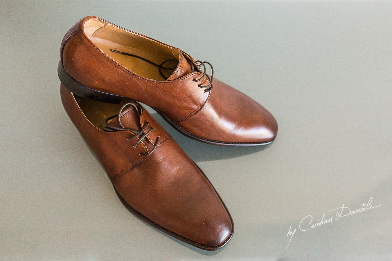 Groom's shoes captured at an elegant and romantic wedding at Elias Beach Hotel by Cristian Dascalu.