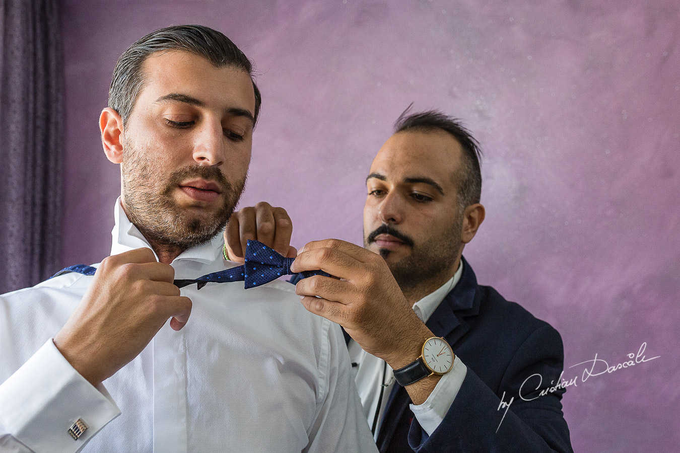 Moments from the groom's getting ready captured at an elegant and romantic wedding at Elias Beach Hotel by Cristian Dascalu.