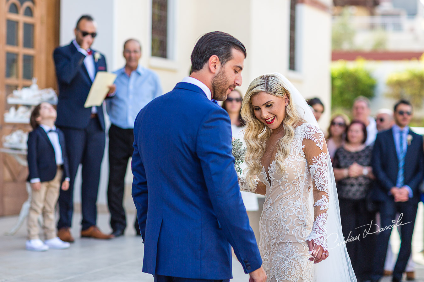 Moments before the church ceremony captured at an elegant and romantic wedding at Elias Beach Hotel by Cristian Dascalu.