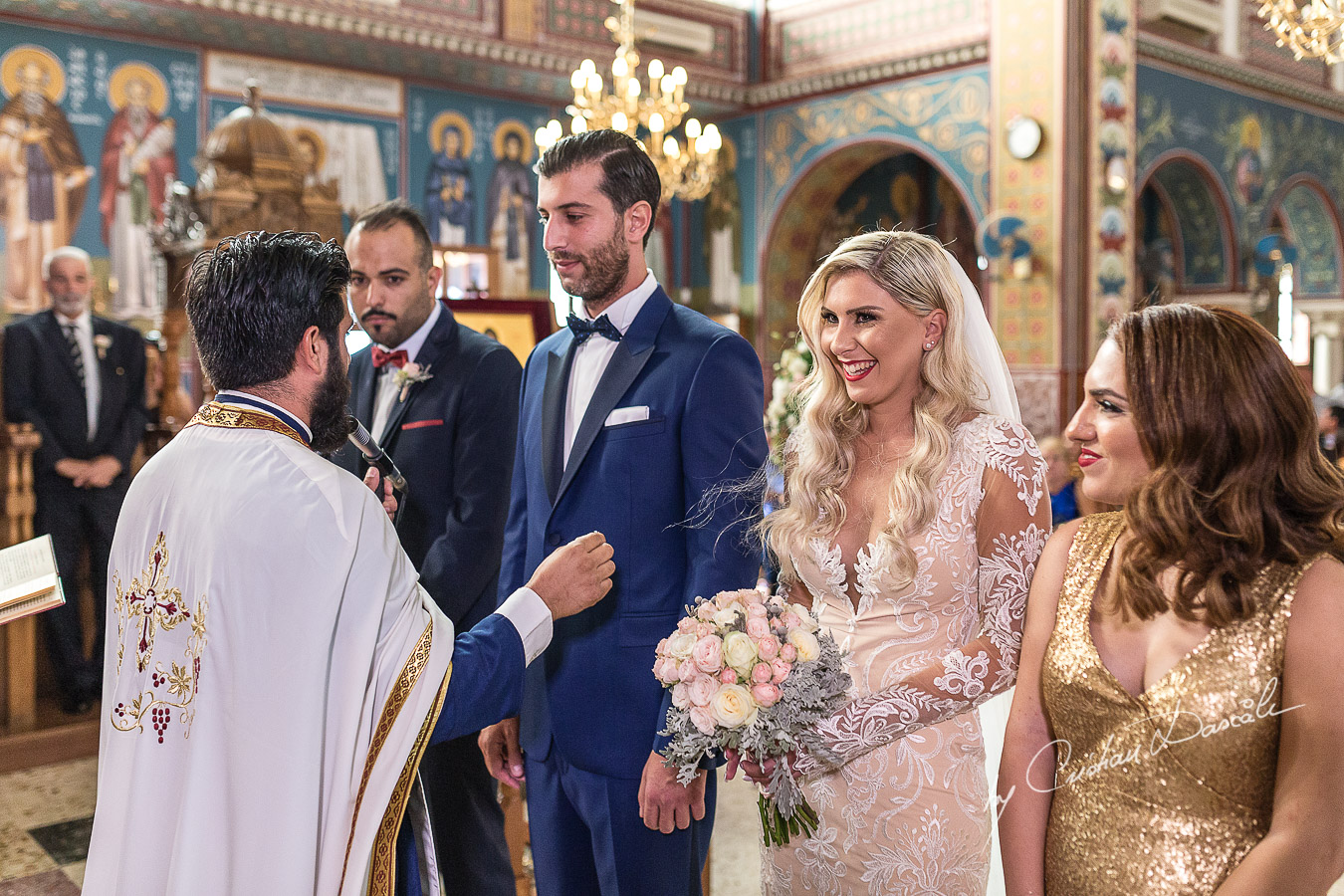 Church ceremony moments captured at an elegant and romantic wedding at Elias Beach Hotel by Cristian Dascalu.