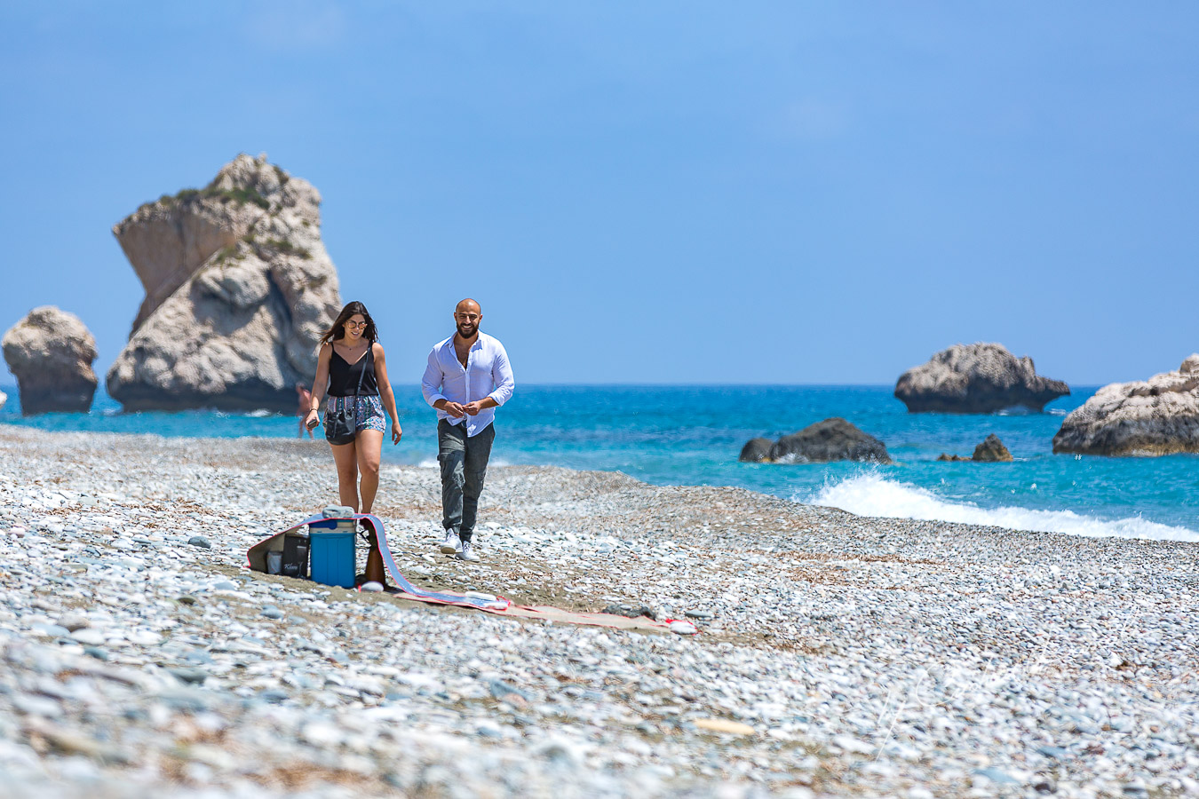Christian and Jana are arriving at the Aphrodite Rocks where Christiana is planning to propose Jana.