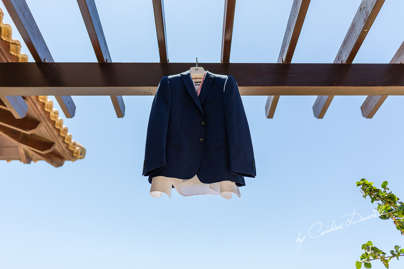 Groom's details at Aphrodite Hills Resort captured during a wedding by Cristian Dascalu.