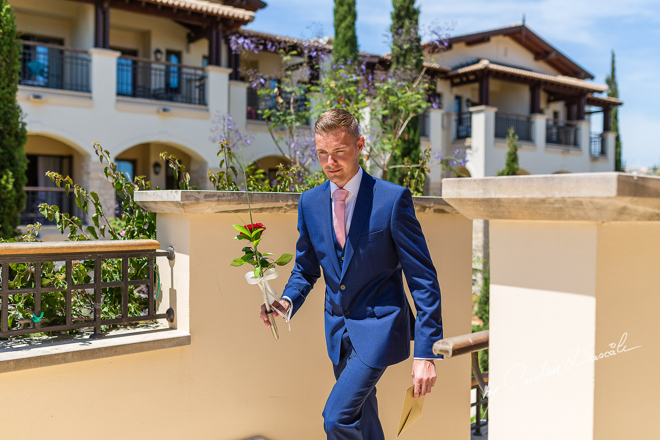 The Bestman delivering a flower and an envelop captured at Aphrodite Hills Resort before the wedding ceremony by Cristian Dascalu.