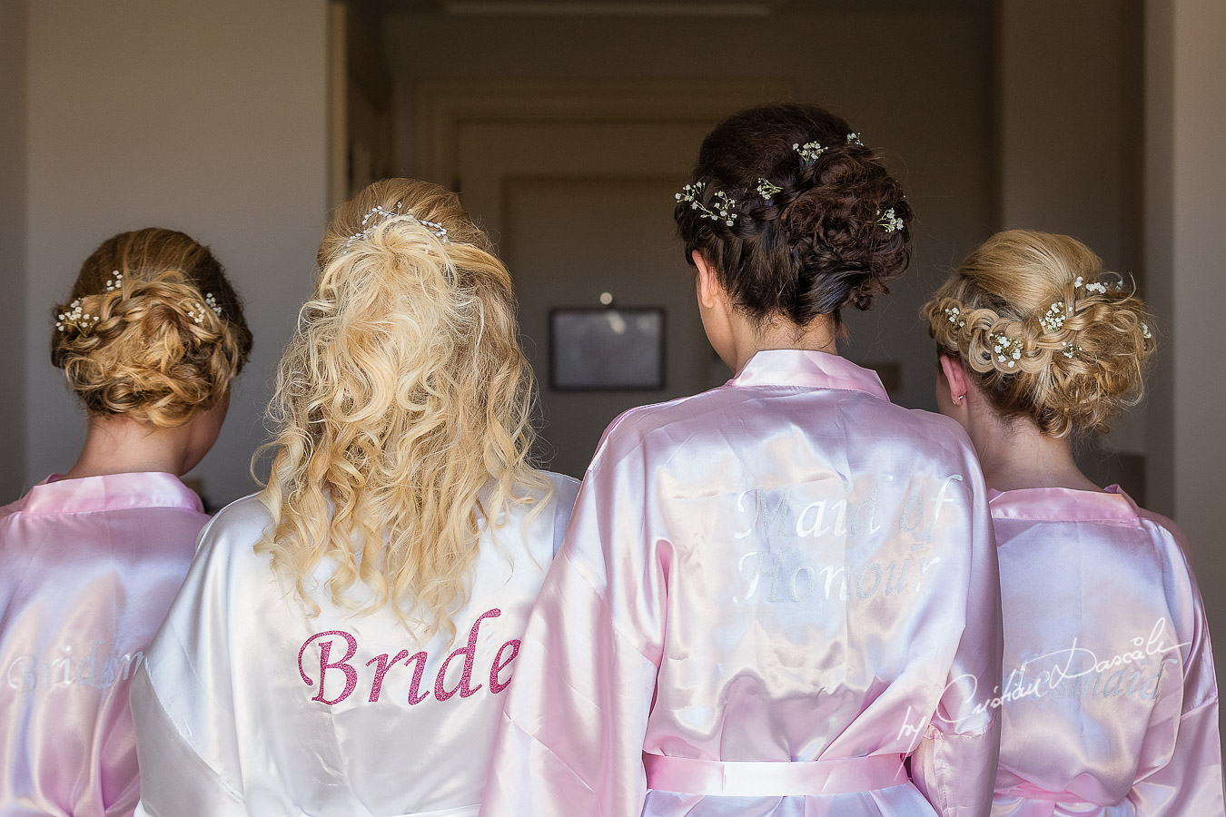 Team Bride is being photographed in the Bridal robe before getting ready at Aphrodite Hills Resort by wedding photographer Cristian Dascalu.