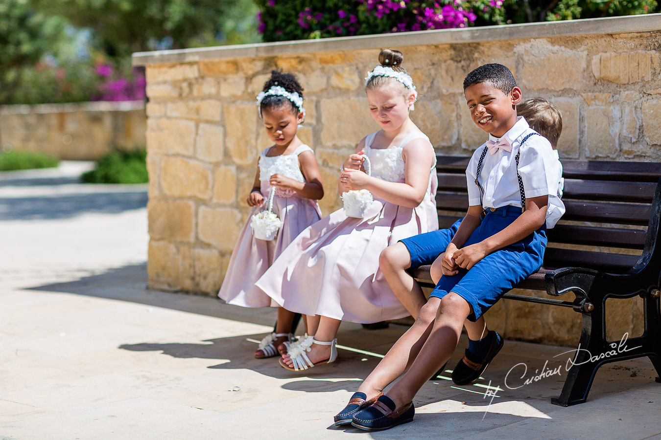 Moments with pageboys and flowergirls captured during a wedding at Aphrodite Hills Resort in Cyprus by Cyprus Photographer Cristian Dascalu.