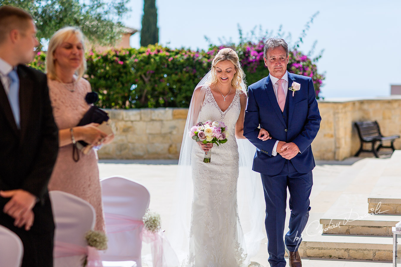The moment when the bride arrives at the wedding ceremony at Aphrodite Hills Resort in Cyprus, captured by photographer Cristian Dascalu.