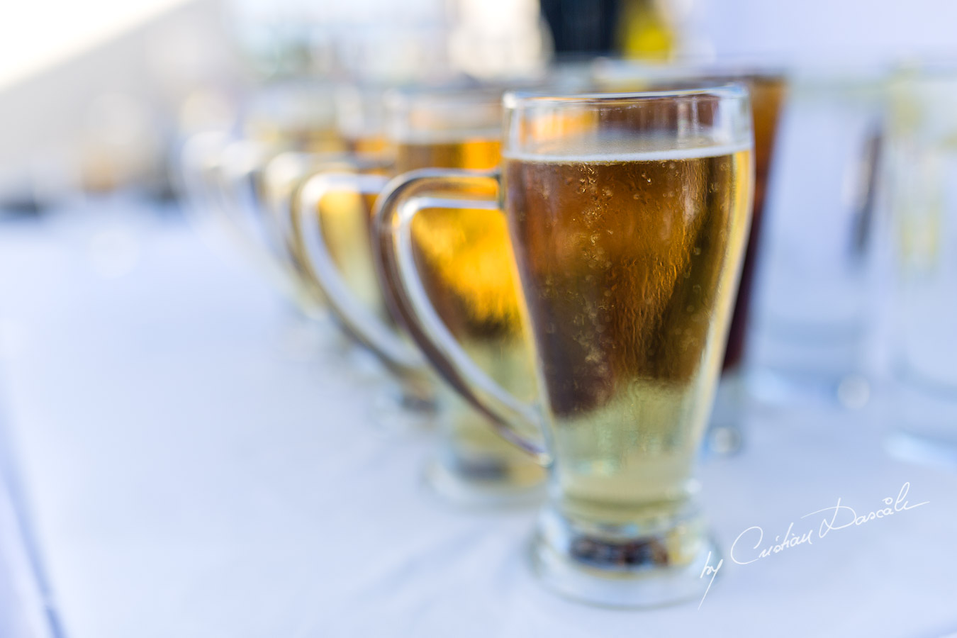 Cold beer on a hot day, captured by Cristian Dascalu at a wedding at The Aphrodite Hills Resort in Paphos, Cyprus.
