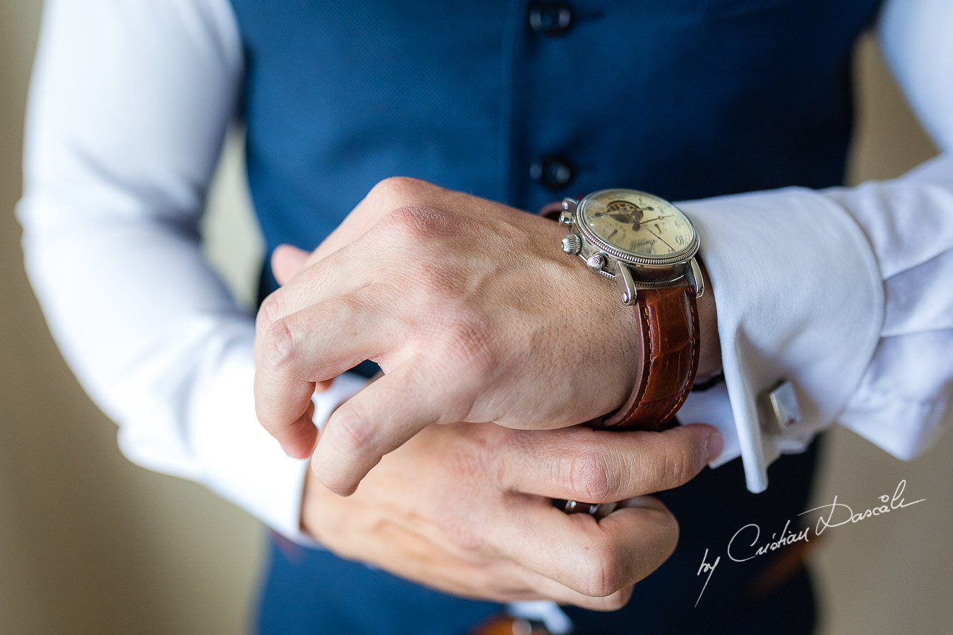 Groom's wearing his watch photographed at a wedding in Nicosia by Cyprus Wedding Photographer Cristian Dascalu