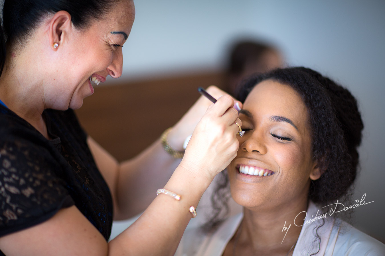 Unique moments captured during the make up for a wedding at Minthis Hills in Cyprus, by Cristian Dascalu.