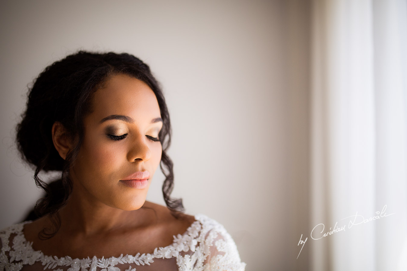 Beautiful bridal portrait captured at a wedding at Minthis Hills in Cyprus, by Cristian Dascalu.