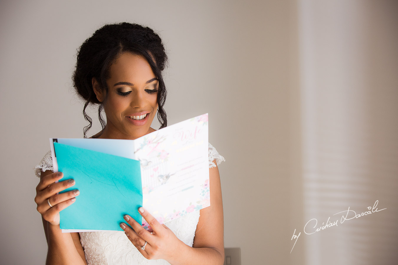 The bride reading her letter from the groom, moments captured at a wedding at Minthis Hills in Cyprus, by Cristian Dascalu.