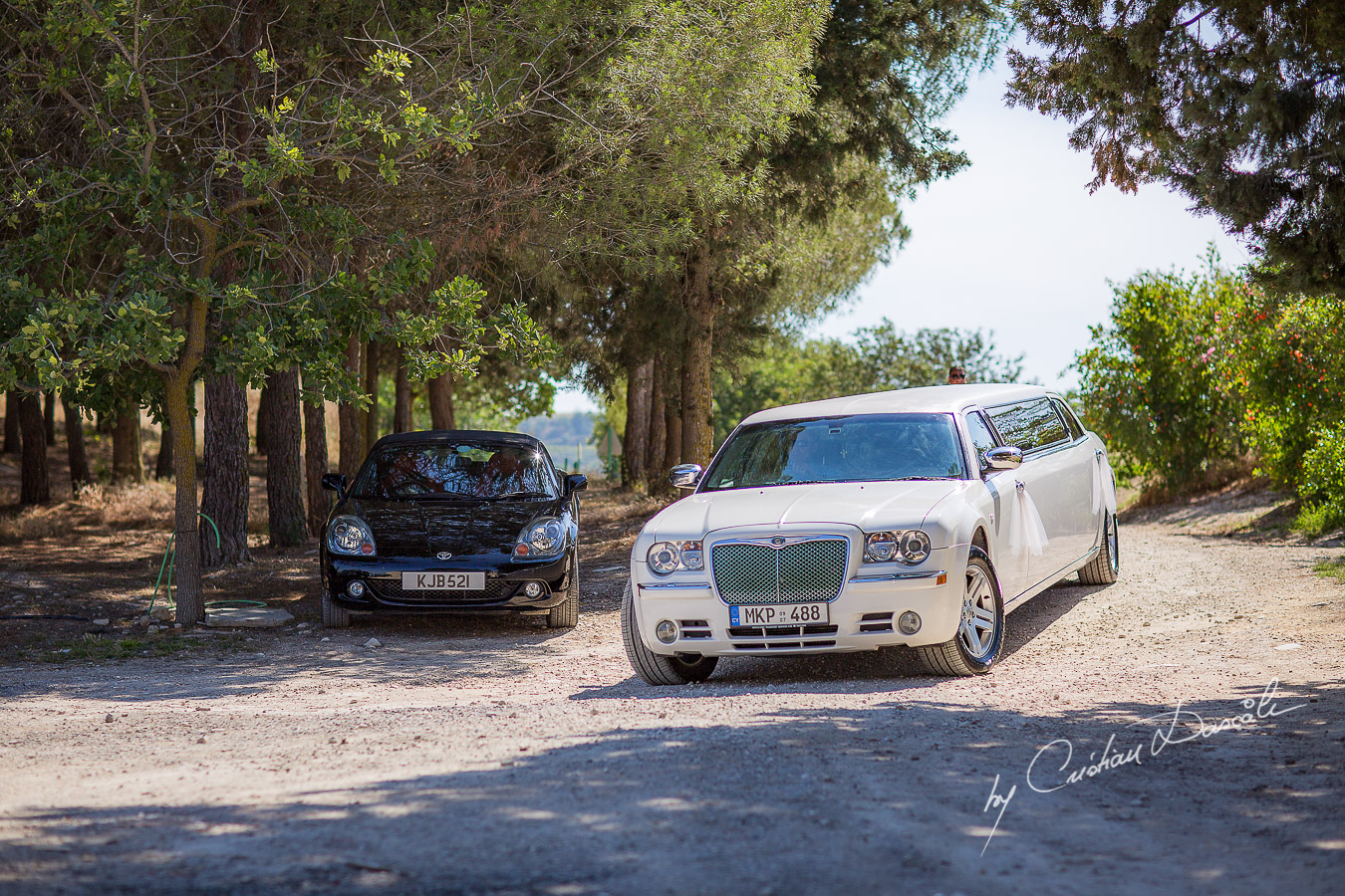 The arrival of the bridal limousine captured at a wedding at Minthis Hills in Cyprus, by Cristian Dascalu.